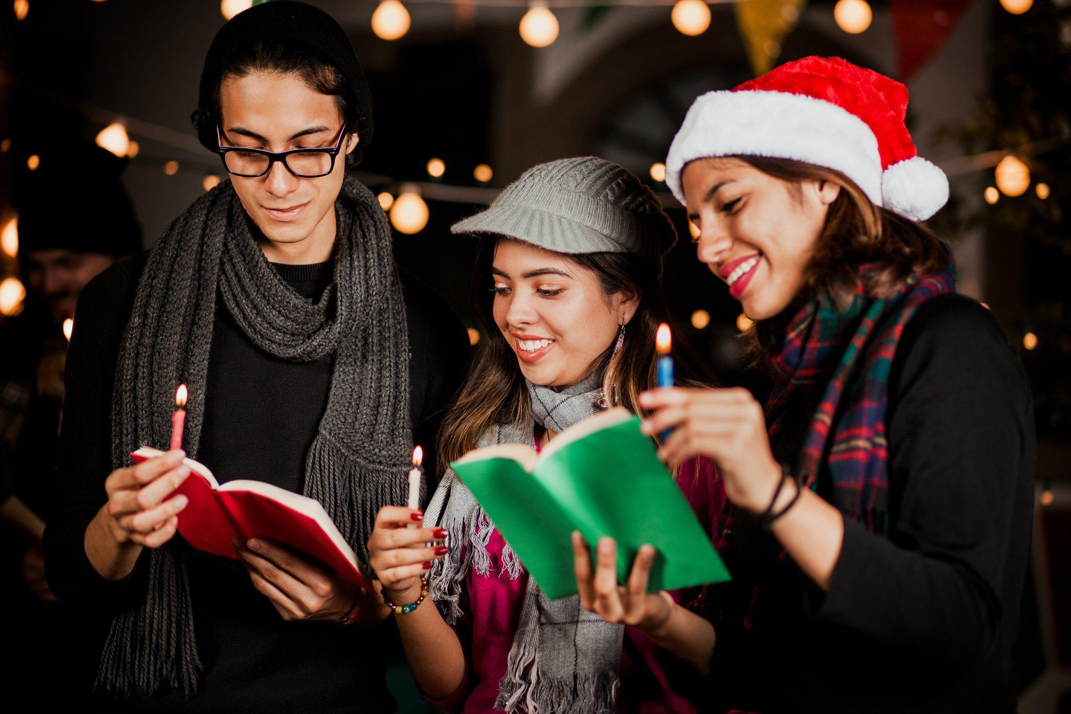Carolers, candles, book, christmas lights